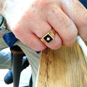 Men's solid 9ct gold black onyx and diamond ring
